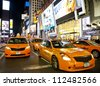 NEW YORK CITY - JUNE 3: Times Square, famous tourist attraction featured with Broadway Theaters and famous restaurant and store locations in New York City, June 3, 2012 in Manhattan, New York City. - stock photo