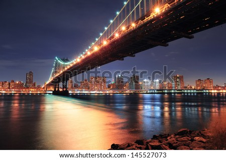 New York City Manhattan Bridge closeup with downtown skyline over East River.