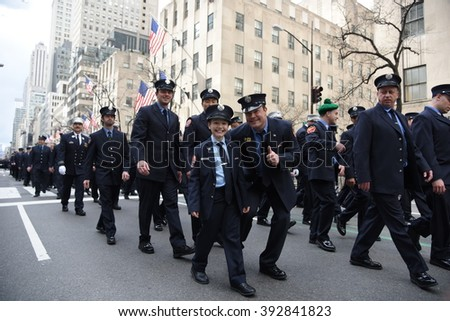 NEW YORK CITY - MARCH 17 2016: Thousands lined 5th Ave to witness Mayor de Blasio march for the first time in the nation's largest St Patrick's Day parade