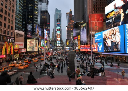 NEW YORK CITY, NY, USA - MARCH 2011: Times Square, New York City, one of the busiest and crowded street intersections in Manhattan with display of neon and LED lights on billboards and shopping malls.