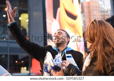 NEW YORK CITY - OCTOBER 18 2015: several hundred pro Israel activists filled Broadway in Times Square to listen to music & rally in support of Israel.