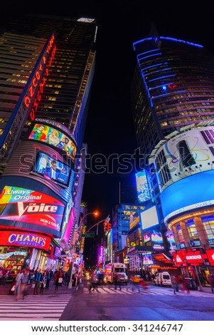 NEW YORK CITY - OCTOBER 08, 2015: Times Square at night with unidentified people. It is one of the worlds busiest pedestrian intersections and a major center of worlds entertainment industry