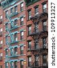 New York City, Old building with fire escape - stock photo