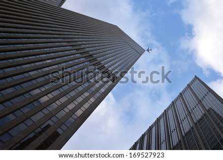New York City skyscrapers and airplanes on sky