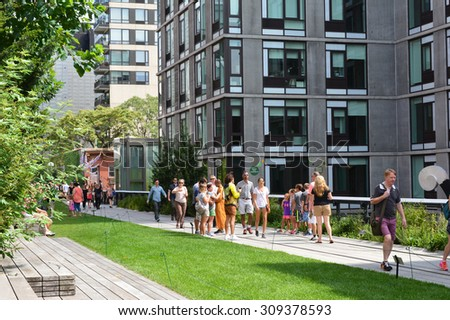 New York City, USA - August 23, 2015: Visitors walking along the path on the High Line on the Lower West Side in New York City.