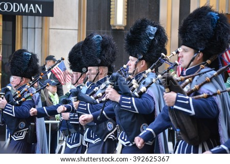 New York City, USA - March 17, 2016: Bagpipe players marching in the St. Patrick's Day Parade in midtown Manhattan in 2016 in New York City.