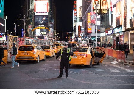 New York City, USA - November 1st, 206: Traffic in Times Square on a regular day, with a policeman in the intersection.