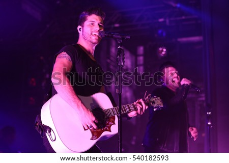NEW YORK-DEC 16: Singers Dan Smyers (L) and Shay Mooney of Dan + Shay perform in concert at PlayStation Theater on December 16, 2016 in New York City.