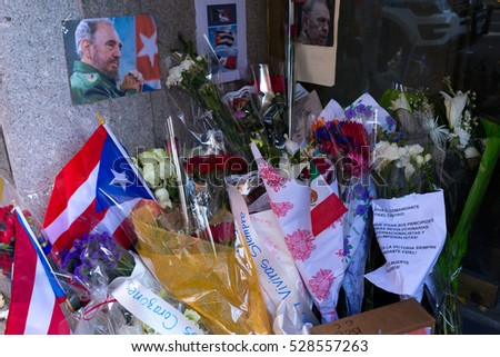 NEW YORK - DECEMBER 3:  Flowers and Photo Memorabilia placed in Honor of The Death of Fidel Castro at The Mision Permanente De Cuba December 3, 2016 in New York City. (Photo by Donald Bowers )