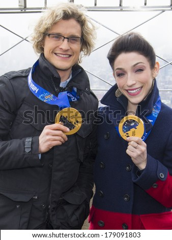 NEW YORK-FEB 27: 2014 Sochi Winter Olympics Champions  Ice Dancers Charlie White and  Meryl Davis (R) visit The Empire State Building on February 27, 2014 in New York City.