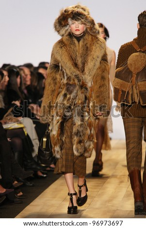 NEW YORK - FEBRUARY 15: Model Anabela Belikova walks the runway at the Michael Kors FW 2012 collection presentation during Mercedes-Benz Fashion Week on February 15, 2012 in New York.
