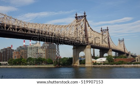 NEW YORK, NEW YORK MAY 1 2014: Queensboro Bridge Over River on May 1 2014 in New York New York