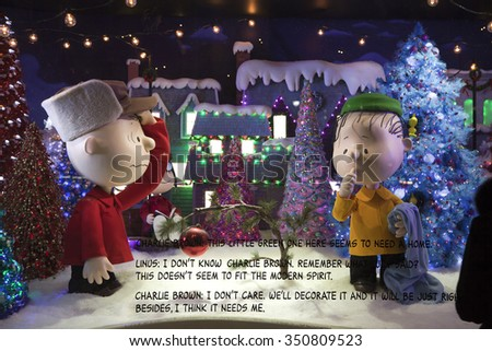NEW YORK, NEW YORK, USA - DECEMBER 10: A Macy's window display for Christmas showing Charlie Brown and Linus picking a Christmas tree.  Taken December 10, 2015 in NY.