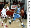 NEW YORK-NOV 3: Sonoma State Seawolves guard Emmanuel Bradford dribbles past St. John's Red Storm guard/forward Amir Garrett (22) at Carnesecca Arena on November 3, 2012 in Jamaica, Queens, New York. - stock photo
