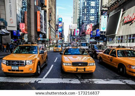 NEW YORK-NOVEMBER 6: Yellow cabs and busy Time Square in Manhattan on November 6, 2013.