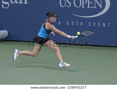 NEW YORK, NY - AUGUST 25: Madison Bringle of USA returns ball during 1st round match against Julia Glushko of Israel at US Open tennis tournament in Flushing Meadows USTA Tennis Center 2014