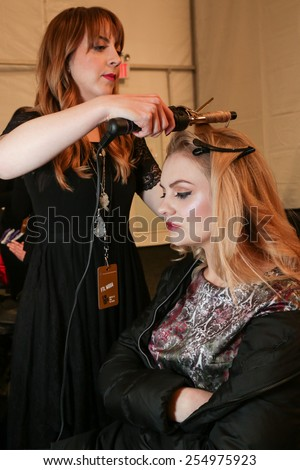 NEW YORK, NY - FEBRUARY 15: A model getting ready backstage at the FTL Moda fashion show during MBFW Fall 2015 at The Salon at Lincoln Center on February 15, 2015 in NYC.