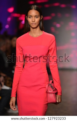 NEW YORK, NY - FEBRUARY 10: A model walks the runway at the DKNY Fall Winter 2013 fashion show during Mercedes-Benz Fashion Week on February 10, 2013, NYC.