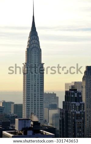 NEW YORK, NY -21 OCTOBER 2015- View of the Manhattan skyline, with the Chrysler building in the background, taken from a high rise building located in Times Square.