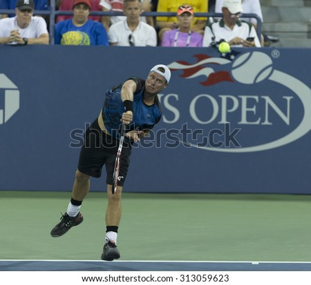 New York, NY - September 3, 2015: Lleyton Hewitt of Australia returns ball during 2nd round match against Bernard Tomic of Australia at US Open championship