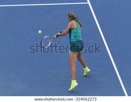 New York, NY - September 5, 2015: Victoria Azarenka of Belarus returns ball during 3rd round match against Angelique Kerber of Germany at US Open Championship