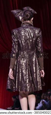 New York, NY, USA - February 14, 2016: A model walks the runway at the David Tupaz runway show during of Fall/Winter 2016 New York STYLE Fashion Week at Gotham Hall, Manhattan.