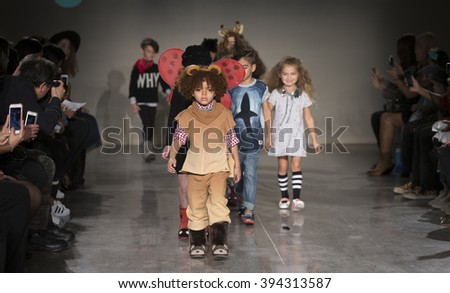 New York, NY USA - March 12, 2016: Young models walk runway for EMU Australia during petiteParade fashion show at Spring studios