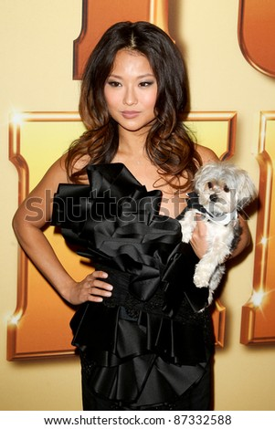 "NEW YORK - OCTOBER 24: Anna Park and Lucky the dog attend the premiere of ""Tower Heist"" at the Ziegfeld Theatre on October 24, 2011 in New York City."