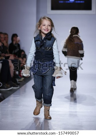 NEW YORK - OCTOBER 5: Girl walks runway for Parsons the New School for Design collection by Paige Fleming at Vogue Bambini petiteParade Kids Fashion Week at Industrial Superstudio on Oct 5 2013 in NYC