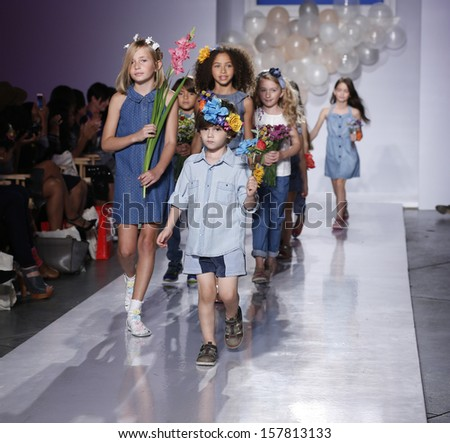 NEW YORK - OCTOBER 6: Kids walk runway for Stride Rite Children's Group at Vogue Bambini petiteParade Kids Fashion Week at Industrial Superstudio on October 6, 2013 in New York City