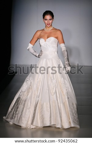 NEW YORK - OCTOBER 17: Model walking runway at the Anne Barge Bridal Collection for Spring/ Summer 2011 during NY Bridal Fashion Week on October 17, 2010 in New York, USA