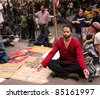 NEW YORK - SEPT. 21:A young man meditates amid the Occupy Wall Street demonstration near the New York Stock Exchange on September 21, 2011 in New York City. - stock photo