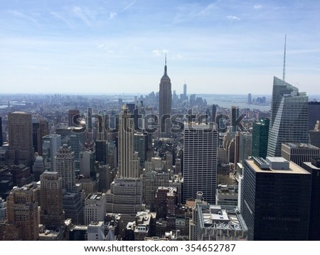 New York, USA - April 19, 2015: Manhattan view with all its famous skyscrapers and buildings, New York City. Rockefeller Center Observation Deck view. Mobile photo.