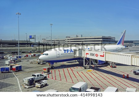 New York, USA - May 7, 2015: Airplane and a jet bridge in JFK international airport