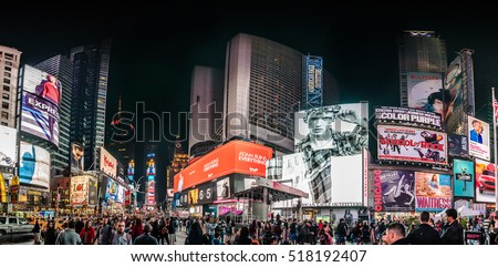 NEW YORK, USA - October 14, 2016. Crowded Times Square High Resolution Panorama at Night and LED Advertising Lighting up the Place in Manhattan, New York