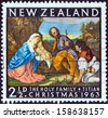 "NEW ZEALAND - CIRCA 1963: A stamp printed in New Zealand from the ""Christmas "" issue shows The Holy Family (by Titian), circa 1963.  - stock photo"