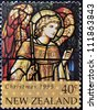 NEW ZEALAND - CIRCA 1995: A stamp printed in New Zealand, is dedicated to Christmas, Stained glass windows, shows Archangel Gabriel, circa 1995 - stock photo