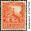 NEW ZEALAND - CIRCA 1931-1944: A stamp printed in New Zealand shows totem carved Maori house, circa 1931-1944 - stock photo