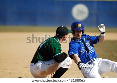 NEWARK, DE - MARCH 7: University of Delaware baseball player Corey Jefferson (R) slides into third base in the March 7, 2010 game in Newark, DE.
