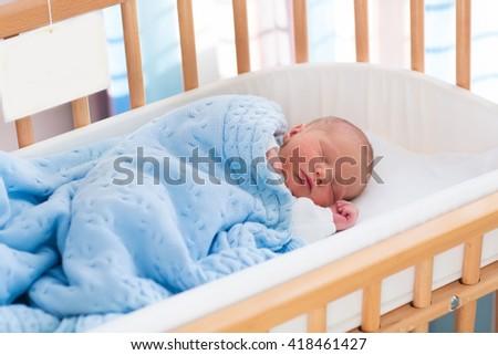Sleeping Cute Newborn Infant Wrapped Baby Stock Photo