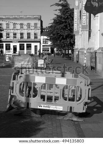 Newbury, Market Place, Berkshire, England - October 03, 2016: Health and safety barriers around pavement repairs with Corn Exchange Theatre in background