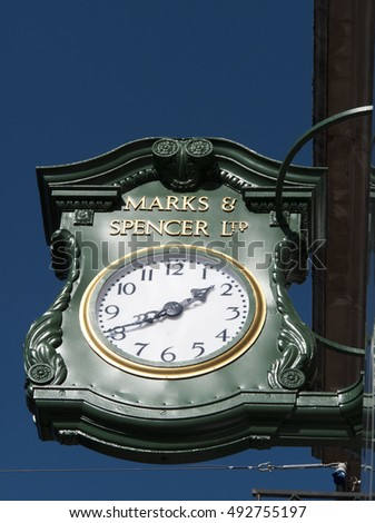 Newbury, Northbrook Street, Berkshire, England - October 03, 2016: Marks and Spenser clock over store, company founded in 1884 by Michael Marks and Thomas Spenser