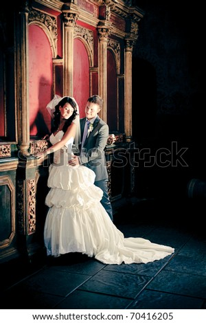 newlyweds standing in the church