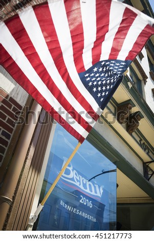 NEWTON, NJ-JULY 4 2016: A Bernie Sanders sign and American Flag in the window of a storefront in the historic downtown area of Newton, NJ on July 4, 2016.