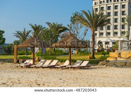 Nha Trang, Vietnam - May 15 2016 : Sunbeds and umbrellas on the beach of Nha Trang, Vietnam