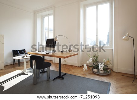 living room computer desk. nice apartment refitted  studio room with furniture retro Modern Living Room Computer Desk Screen Stock Photo 92358796