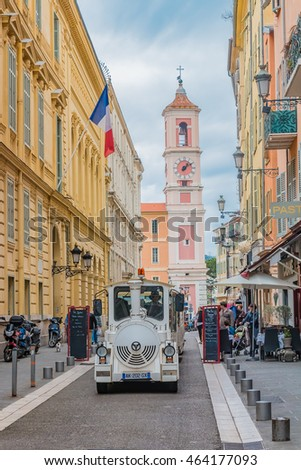 Nice, France - April 21, 2016: Narrow streets the the Old Town, Vieille Ville and a tourist train driving through
