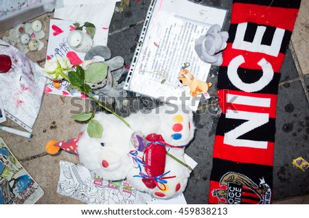 NICE,FRANCE -  JULY 26: people bring flowers and dolls to remember the victims of the terrorist attack of the 14th july on the 26th of july 2016 in Nice, France.