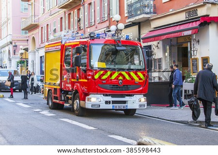 NICE, FRANCE, on JANUARY 7, 2016. City landscape, winter day. The fire truck has stopped near the sidewalk