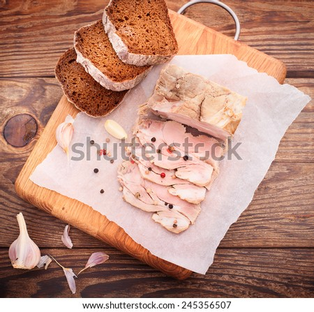 nice juicy meat with spices and bread on the wooden table
